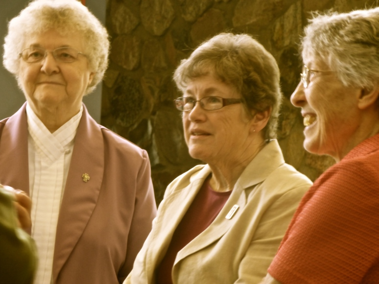 Sisters speak with guests after Mass