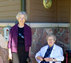 Sisters Carol and Jane Frances enjoy a sunny day outside