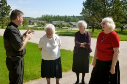Fr. Mark McCormick and Sisters share in conversation
