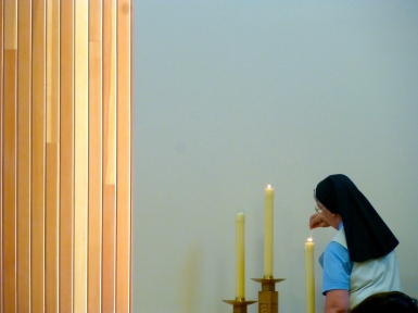 Sr. Bernadette lights the candles for Mass