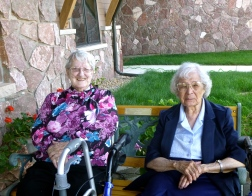 Sisters Rosemary and Juanita enjoy the sunshine and flowers outside