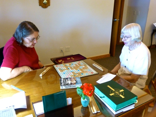 Sisters Eleanor and Loran play Scrabble