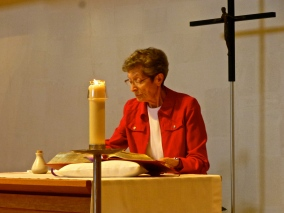Sr. Gemma prepares the altar for Mass at Annunciation Monastery